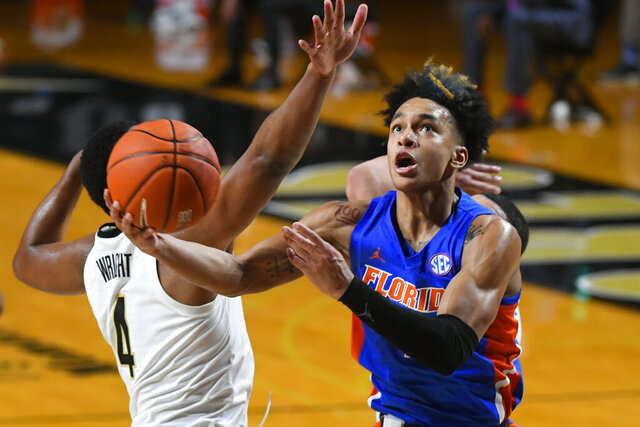 Florida guard Tre Mann shoots as Vanderbilt guard Jordan Wright (4) defends during the second half of an NCAA college basketball game Wednesday, Dec. 30, 2020, in Nashville, Tenn. (AP Photo/John Amis)