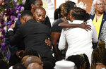 Mourners hug relatives of Debra Johnson is carried into the sanctuary at Temple Church before her funeral Friday, Aug. 16, 2019, in Nashville, Tenn. Johnson was a former Tennessee Department of Correction administrator slain earlier in the month.(Larry McCormack/The Tennessean via AP, Pool)