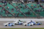 Drivers head to turn one during the second lap of a NASCAR Truck Series auto race at Kansas Speedway in Kansas City, Kan., Saturday, May 1, 2021. (AP Photo/Colin E. Braley)