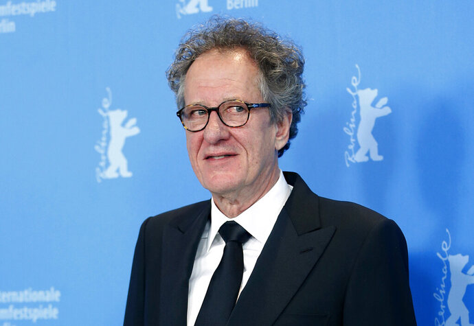 FILE - In this Feb. 12, 2013 file photo, actor Geoffrey Rush poses at the photo call for the film The Best Offer at the 63rd edition of the Berlinale, International Film Festival in Berlin. Oscar-winning actor Rush has been was awarded 2.9 million Australian dollars ($2 million) damages in a defamation case against a newspaper publisher and journalist over reports he had been accused of inappropriate behavior toward an actress. (AP Photo/Michael Sohn, File)