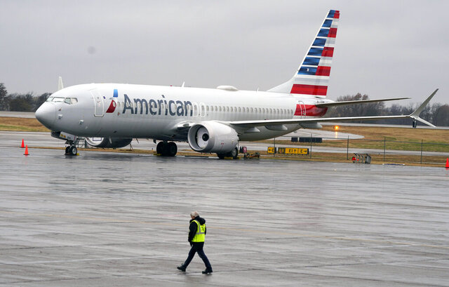 FILE - In this Dec. 2, 2020 file photo, an American Airlines Boeing 737 Max jet plane is parked at a maintenance facility in Tulsa, Okla.  Paying passengers were scheduled to board a Boeing 737 Max in Miami on Tuesday, Dec. 29 for the first time since safety regulators allowed the plane to fly again after two deadly crashes. The American Airlines flight is scheduled to land at New York's LaGuardia Airport with about 100 passengers aboard, according to an airline spokeswoman. (AP Photo/LM Otero, File)