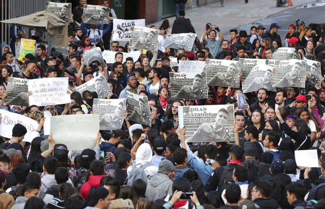 Students hold up posters with the image of Dilan Cruz who was injured during clashes between anti-government protesters and police, during a demonstration demanding justice for Dilan, in Bogota, Colombia, Tuesday, Nov. 26, 2019. Cruz, an 18-year-old high school student, died two days after being hit in the head by a projectile reportedly fired by riot police during a protest. (AP Photo/Fernando Vergara)