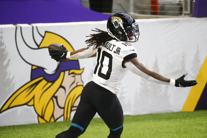 Jacksonville Jaguars wide receiver Laviska Shenault Jr. celebrates after catching a 28-yard touchdown pass during the first half of an NFL football game against the Minnesota Vikings, Sunday, Dec. 6, 2020, in Minneapolis. (AP Photo/Bruce Kluckhohn)