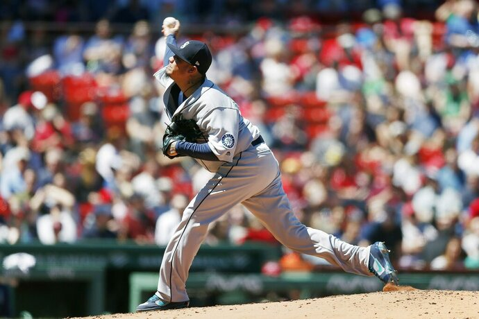Seattle Mariners' Felix Hernandez pitches during the first inning of a baseball game against the Boston Red Sox in Boston, Saturday, May 11, 2019. (AP Photo/Michael Dwyer)