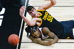 Illinois guard Ayo Dosunmu (11) and Iowa center Luka Garza (55) watches as the ball goes out of bounds in the first half of an NCAA college basketball game at the Big Ten Conference tournament in Indianapolis, Saturday, March 13, 2021. (AP Photo/Michael Conroy)