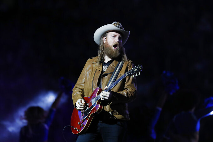 John Osborne of the Brothers Osborne duo performs during halftime of an NFL football game between the Detroit Lions and the Chicago Bears, Thursday, Nov. 28, 2019, in Detroit. (AP Photo/Paul Sancya)