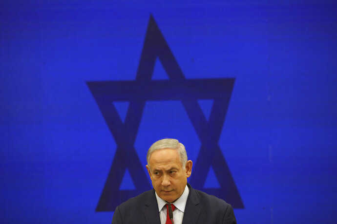 FILE - In this Tuesday, Sept. 10, 2019 file photo, Israeli Prime Minister Benjamin Netanyahu, speaks during a press conference in Tel Aviv, Israel. For the second time this year, Israel's long-serving Prime Minister faces off again against a former military chief, Benny Gantz, in national elections. Opinion polls show Netanyahu's Likud and Gantz's Blue and White locked in a close battle. (AP Photo/Oded Balilty, File)