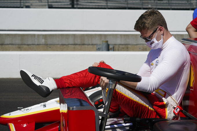 Josef Newgarden waits in a cart during qualifications for the Indianapolis 500 auto race at Indianapolis Motor Speedway, Saturday, Aug. 15, 2020, in Indianapolis. (AP Photo/Darron Cummings)