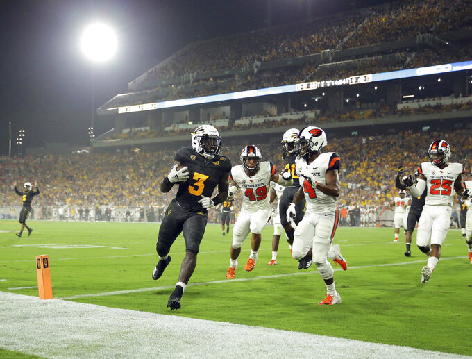 Arizona State running back Eno Benjamin (3) scores a touchdown as Oregon State cornerback Dwayne Williams (4) and linebacker Andrzej Hughes-Murray (49) defend during the first half of an NCAA college football game Saturday, Sept. 29, 2018, in Tempe, Ariz. (AP Photo/Matt York)