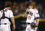 Arizona Diamondbacks starting pitcher Zack Greinke (21) pauses on the mound with catcher Jeff Mathis, left, just before Greinke is taken out in the fifth inning of a baseball game against the Pittsburgh Pirates, Wednesday, June 13, 2018, in Phoenix. (AP Photo/Ross D. Franklin)