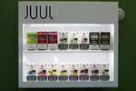 FILE - In this Sept. 3, 2019, file photo, electronic cigarette pods are displayed for sale at a shop, in Biddeford, Maine. Today Juul and hundreds of smaller companies are at the center of a political backlash that threatens to sweep e-cigarettes from stores shelves nationwide as politicians scramble to address two separate public health crises tied to vaping: underage use among teenagers and a mysterious and sometimes fatal lung ailment that affected more than a thousand people. (AP Photo/Robert F. Bukaty, File)