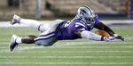 Kansas State defensive end Reggie Walker dives in a failed attempt to intercept a pass during the second half of an NCAA college football game against South Dakota Saturday, Sept. 1, 2018, in Manhattan, Kan. Kansas State won 27-24. (AP Photo/Charlie Riedel)