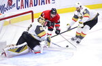 Vegas Golden Knights goaltender Marc-Andre Fleury (29) pokes the puck as Ottawa Senators right wing Tyler Ennis (63) attempts to score during the third period of an NHL hockey game, Thursday, Jan. 16, 2020 in Ottawa, Ontario. (Sean Kilpatrick/The Canadian Press via AP)