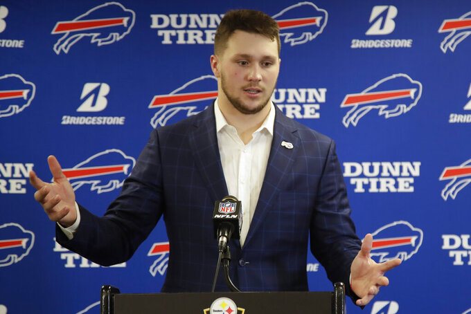 Buffalo Bills quarterback Josh Allen takes questions during a news conference after an NFL football game against the Pittsburgh Steelers, Sunday, Dec. 15, 2019, in Pittsburgh. The Bills won, 17-10. (AP Photo/Don Wright)