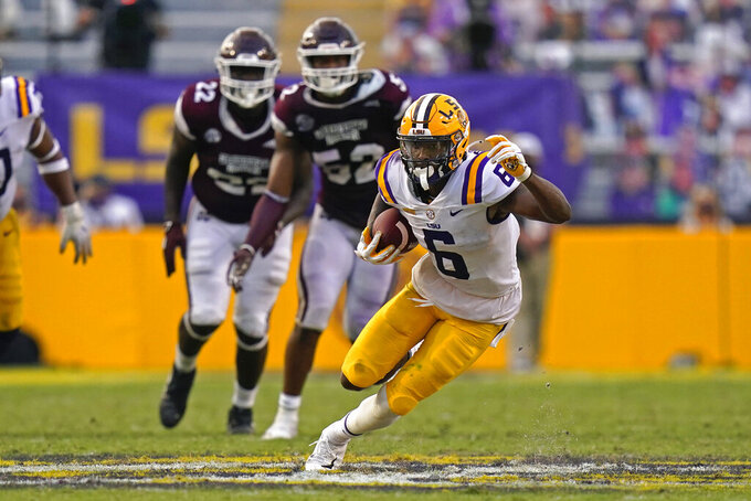 LSU wide receiver Terrace Marshall Jr. (6) carries ahead of Mississippi State defensive end Kobe Jones (52) and defensive tackle Nathan Pickering (22) in the second half an NCAA college football game in Baton Rouge, La., Saturday, Sept. 26, 2020. Mississippi State won 44-34. (AP Photo/Gerald Herbert)