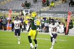 Green Bay Packers' Robert Tonyan catches a touchdown pass during the second half of an NFL football game against the Chicago Bears Sunday, Nov. 29, 2020, in Green Bay, Wis. (AP Photo/Mike Roemer)