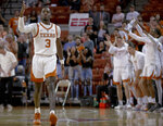 Texas guard Courtney Ramey (3) celebrates a 3-pointer against Colorado during an NCAA college basketball game in the quarterfinals of the NIT on Wednesday, March 27, 2019, in Austin, Texas. (Nick Wagner/Austin American-Statesman via AP)