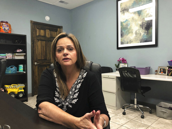 In this Oct. 30, 2019, photo, Sherry Russell discusses the death of her son at the Gallia County Jail in southern Ohio at her medical care business in Rio Grande, Ohio. Russell wants to know how her son was able to commit suicide while kept in an isolation cell that was supposed to be under constant surveillance. (AP Photo/Mark Gillispie)