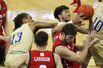 Washington forward Hameir Wright (13) and Utah forward Timmy Allen upper right, battle for the ball during the first half of an NCAA college basketball game, Sunday, Jan. 24, 2021, in Seattle. (AP Photo/Ted S. Warren)