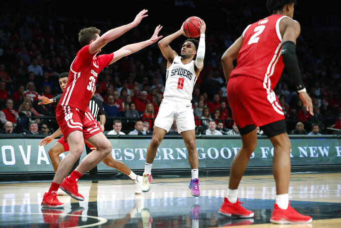Wisconsin forward Nate Reuvers (35) defends as Richmond guard Jacob Gilyard (0) takes a shot during the second half of an NCAA college basketball game in the Legends Classic, Monday, Nov. 25, 2019, in New York. Richmond defeated Wisconsin 62-52. (AP Photo/Kathy Willens)