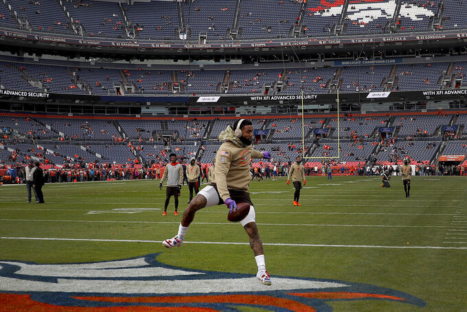 Cleveland Browns wide receiver Odell Beckham warms up prior to an NFL football game against the Denver Broncos, Sunday, Nov. 3, 2019, in Denver. (AP Photo/David Zalubowski)