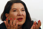 Performance artist Marina Abramovic gestures during the press conference for her art exhibition