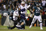 New England Patriots' Tom Brady (12) is tackled by Philadelphia Eagles' Derek Barnett (96) and Nate Gerry (47) during the first half of an NFL football game, Sunday, Nov. 17, 2019, in Philadelphia. (AP Photo/Matt Rourke)
