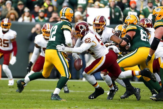 Washington Redskins' Ryan Anderson strips the ball from Green Bay Packers' Aaron Rodgers during the first half of an NFL football game Sunday, Dec. 8, 2019, in Green Bay, Wis. The Redskins recovered the fumble. (AP Photo/Matt Ludtke)