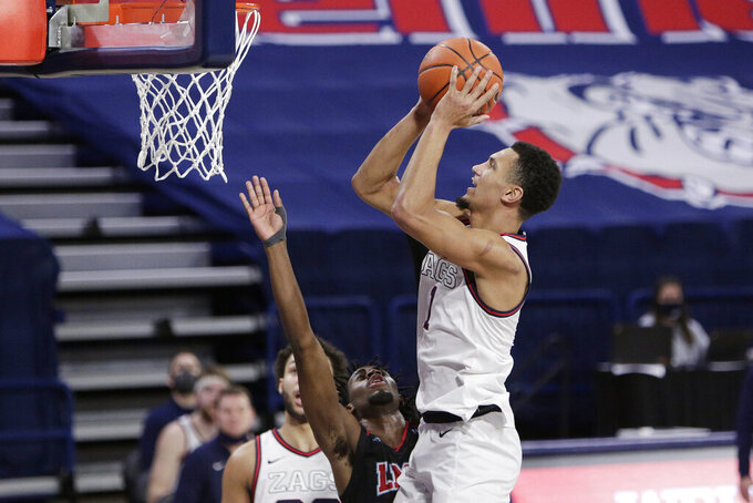 Gonzaga guard Jalen Suggs, right, shoots over Loyola Marymount guard Jalin Anderson during the second half of an NCAA college basketball game in Spokane, Wash., Saturday, Feb. 27, 2021. Gonzaga won 86-69. (AP Photo/Young Kwak)