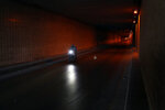 A food deliveryman on a scooter moves in an empty tunnel during a lockdown aimed at curbing the spread of the coronavirus, in Beirut Lebanon, Thursday, Jan. 21, 2021. Authorities on Thursday extended a nationwide lockdown by a week to Feb. 8 amid a steep rise in coronavirus deaths and infections that has overwhelmed the health care system. (AP Photo/Bilal Hussein)