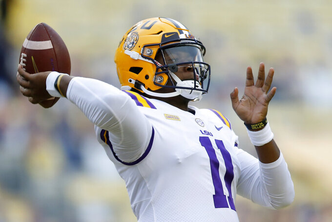LSU quarterback TJ Finley (11) warms up before an NCAA college football game against South Carolina in Baton Rouge, La. Saturday, Oct. 24, 2020. (AP Photo/Brett Duke)
