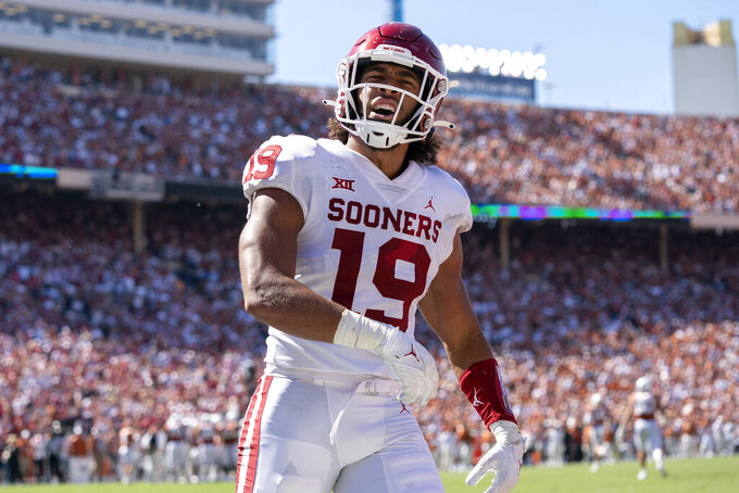 Oklahoma linebacker Caleb Kelly (19) celebrates after stripping the ball on a kickoff during the second half of an NCAA college football game against Texas at the Cotton Bowl, Saturday, Oct. 9, 2021, in Dallas. (AP Photo/Jeffrey McWhorter)