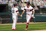 Chicago White Sox's Adam Engel, right, is congratulated by third base coach Nick Capra after his solo home run during the fifth inning of a baseball game against the Chicago Cubs in Chicago, Sunday, Sept. 27, 2020. (AP Photo/Nam Y. Huh)