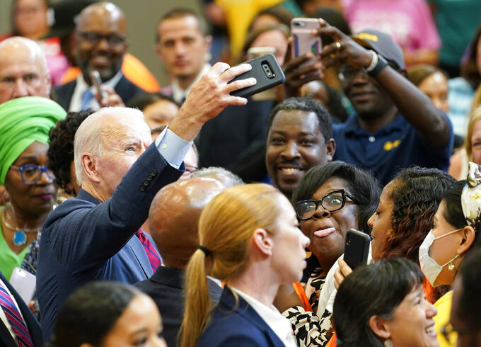 President Joe Biden takes a selfie with members of the audience after speaking during a visit to a mobile COVID-19 vaccination unit at the Green Road Community Center in Raleigh, N.C., Thursday, June 24, 2021. (AP Photo/Susan Walsh)