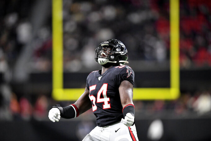 Atlanta Falcons linebacker Foye Oluokun (54) reaches ts after a Atlanta Falcons recovery on a kickoff against the New Orleans Saints during the second half of an NFL football game, Thursday, Nov. 28, 2019, in Atlanta. The New Orleans Saints won 26-18. (AP Photo/Danny Karnik)