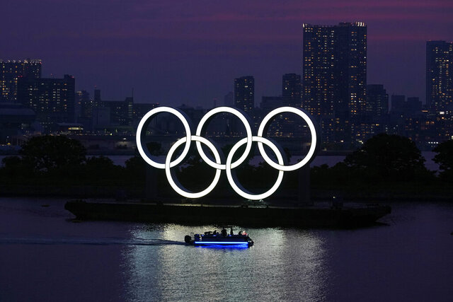 FILE - In this June 3, 2020, photo, the Olympic rings float in the water at sunset in the Odaiba section in Tokyo. Masa Takaya, the spokesman for the Tokyo Olympics, said Thursday, July 9, 2020, he's confident the postponed games can be held in 2021 despite a recent poll in Japan in which 77% of respondents said they did not believe the games could be held next year. (AP Photo/Eugene Hoshiko, File)