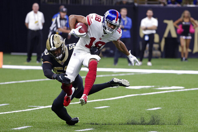 New York Giants wide receiver C.J. Board (18) tries to elude a tackle by New Orleans Saints linebacker Zack Baun (53) in the first half of an NFL football game in New Orleans, Sunday, Oct. 3, 2021. (AP Photo/Derick Hingle)