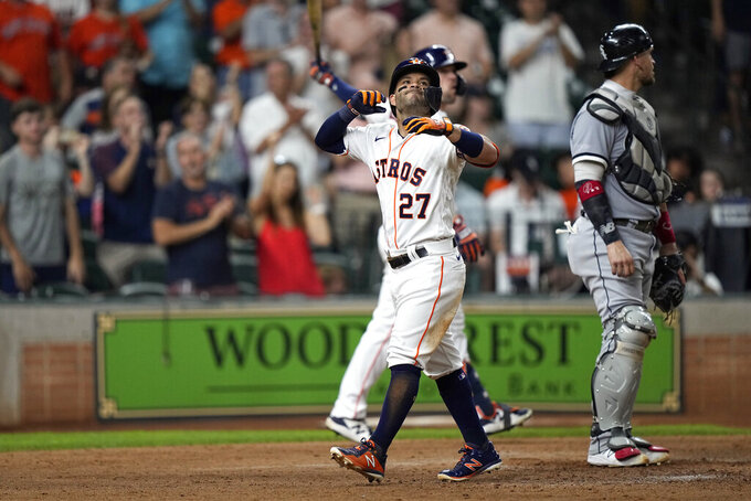 Houston Astros' Jose Altuve (27) celebrates after hitting a home run against the Chicago White Sox during the sixth inning of a baseball game Thursday, June 17, 2021, in Houston. (AP Photo/David J. Phillip)