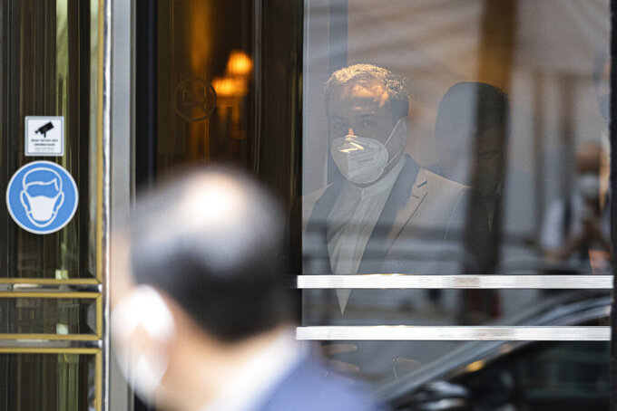 CAPTION CORRECTS SPELLING OF SURNAME Political deputy at the Ministry of Foreign Affairs of Iran, Abbas Araghchi leaves the 'Grand Hotel Vienna' where closed-door nuclear talks take place in Vienna, Austria, Saturday, June 12, 2021. (AP Photo/Florian Schroetter)