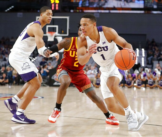 TCU guard Desmond Bane (1) rounds the corner during the first half of the team's NCAA college basketball game against Southern California in Fort Worth, Texas, Friday, Dec. 6, 2019. (Bob Booth/Star-Telegram via AP)