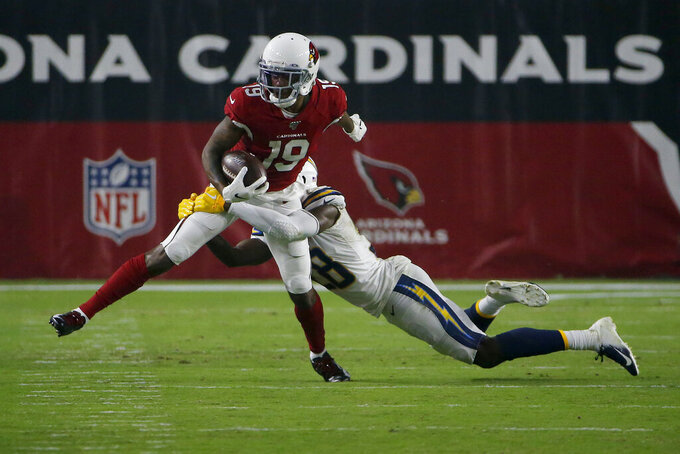 Arizona Cardinals wide receiver KeeSean Johnson (19) is hit by Los Angeles Chargers defensive back Brandon Facyson during the first half of an NFL preseason football game, Thursday, Aug. 8, 2019, in Glendale, Ariz. (AP Photo/Rick Scuteri)