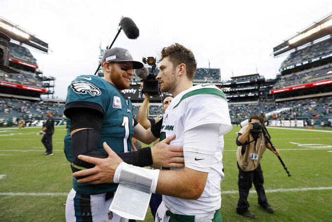 Philadelphia Eagles' Carson Wentz, left, and New York Jets' Luke Falk meet after an NFL football game, Sunday, Oct. 6, 2019, in Philadelphia. (AP Photo/Michael Perez)