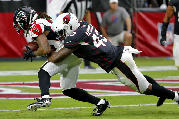 Atlanta Falcons running back Devonta Freeman (24) runs into the end zone for a touchdown as Arizona Cardinals outside linebacker Haason Reddick (43) defends during the second half of an NFL football game, Sunday, Oct. 13, 2019, in Glendale, Ariz. (AP Photo/Rick Scuteri)