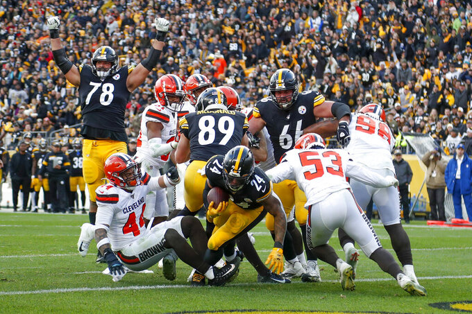 Pittsburgh Steelers running back Benny Snell (24) breaks through the line of scrimmage for a touchdown against the Cleveland Browns during the second half of an NFL football game, Sunday, Dec. 1, 2019, in Pittsburgh. (AP Photo/Don Wright)