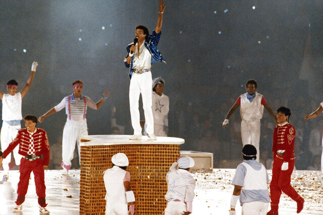 FILE - In this Aug. 12, 1984, file photo, American singer Lionel Ritchie performs during the closing ceremony of the Summer Olympics Games in Los Angeles, (AP Photo/File)