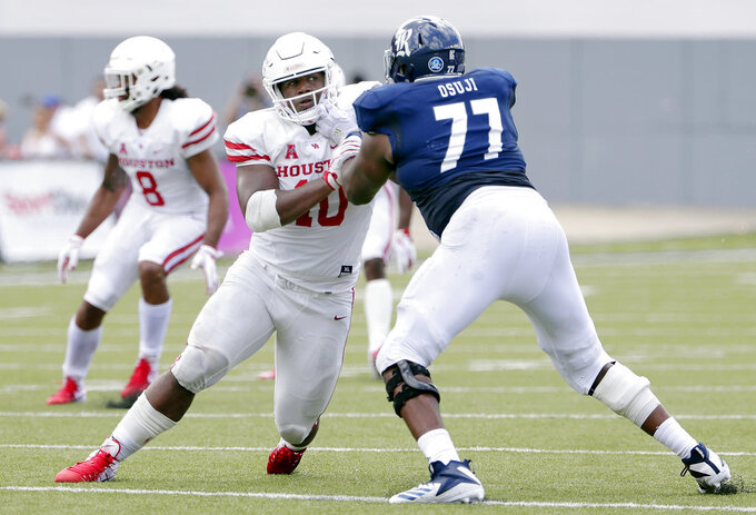 FILE - In this Sept. 1, 2018, file photo, Houston defensive tackle Ed Oliver (10) works to get around Rice offensive lineman Uzoma Osuji (77) during a NCAA college football game, in Houston. Oliver was named to The Associated Press Midseason All-America team, Tuesday, Oct. 16, 2018.(AP Photo/Michael Wyke, File)