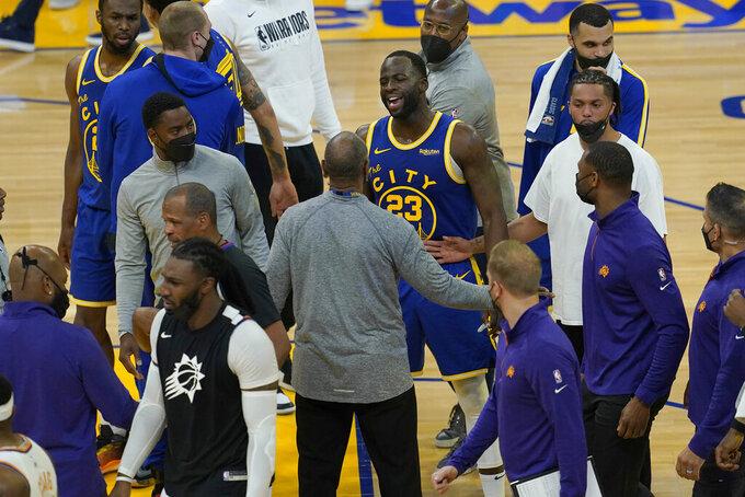 Golden State Warriors forward Draymond Green (23) talks toward Phoenix Suns players during halftime of an NBA basketball game in San Francisco, Tuesday, May 11, 2021. (AP Photo/Jeff Chiu)