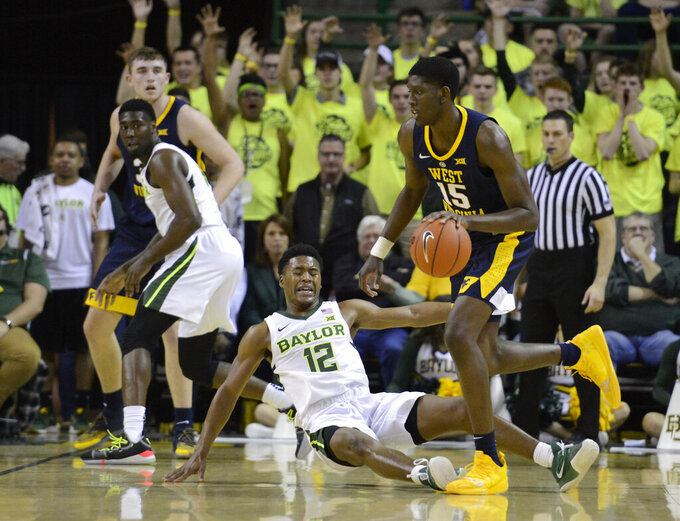 West Virginia forward Lamont West (15) drives around Baylor guard Jared Butler (12) in the second half of an NCAA college basketball game, Saturday, Feb. 23, 2019, in Waco, Texas. Baylor won 82-75. (Ernesto Garcia/Waco Tribune-Herald via AP)