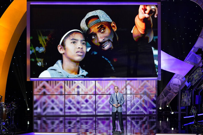 Former NFL quarterback Peyton Manning pays tribute to Kobe Bryant and his daughter Gianna at the NFL Honors football award show Saturday, Feb. 1, 2020, in Miami. (AP Photo/David J. Phillip)