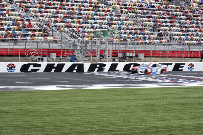 Kyle Busch speeds past the finish line during qualifying for the NASCAR Cup Series auto race at Charlotte Motor Speedway on Saturday, May 29, 2021 in Charlotte, N.C. (AP Photo/Ben Gray)